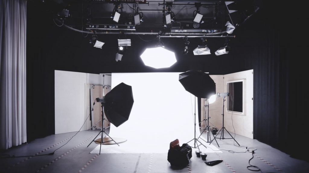 A studio with lighting and video equipment for video production