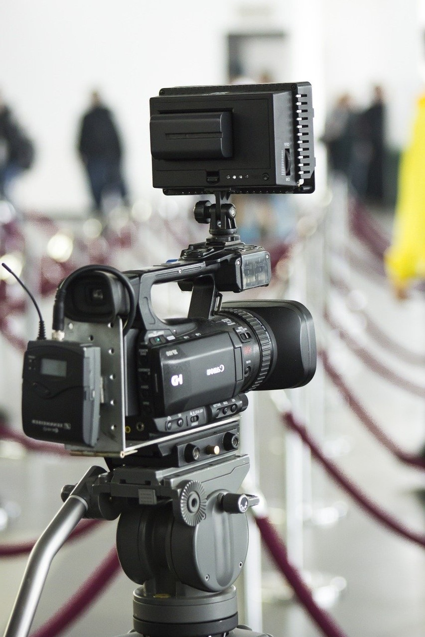 a video production camera up close with blurry background
